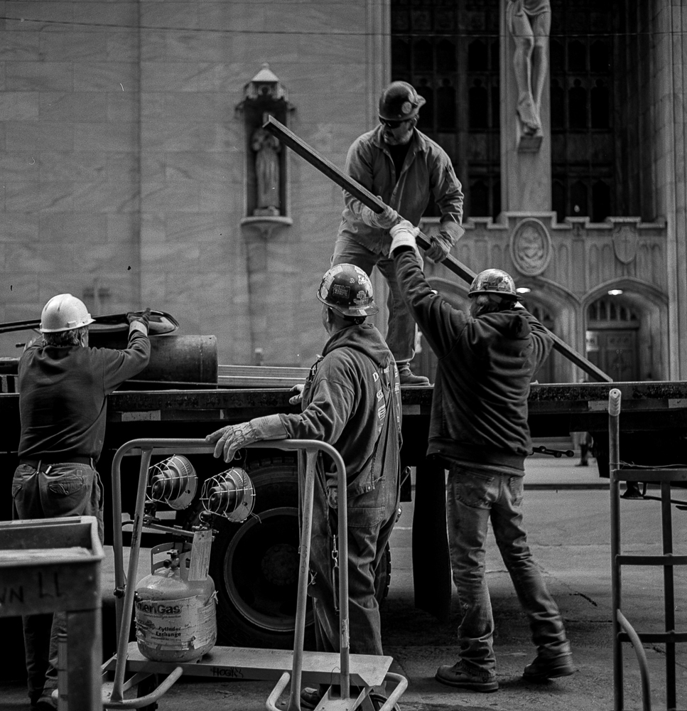 A group of custruction workers working together