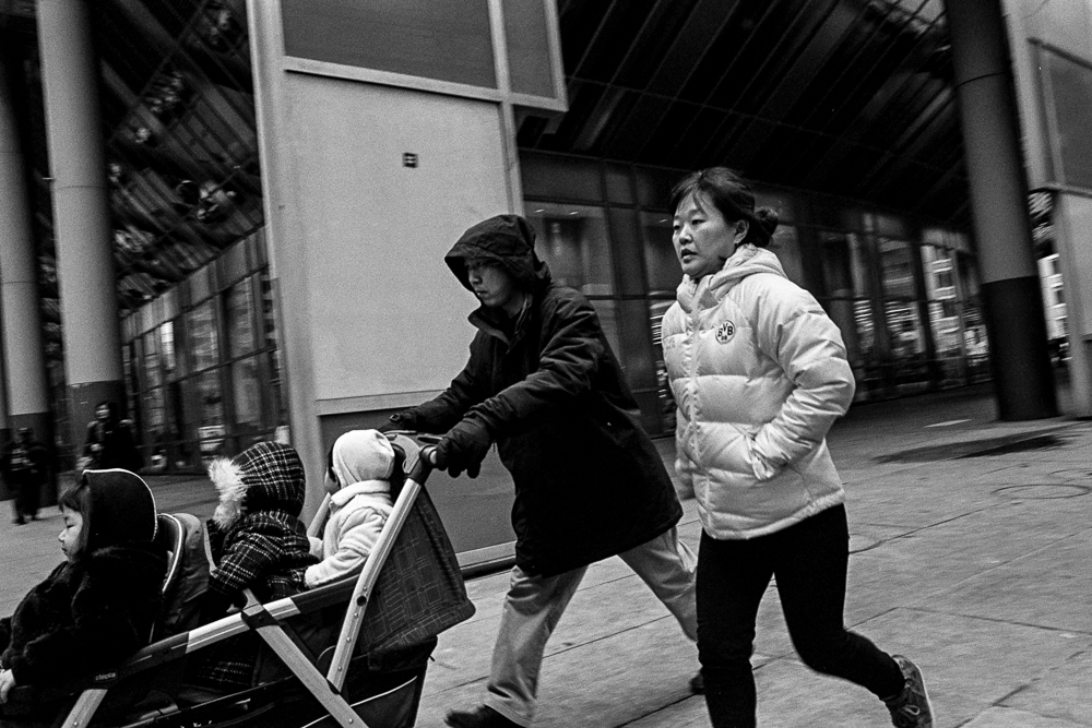 A mother and father jogging with a baby stroller