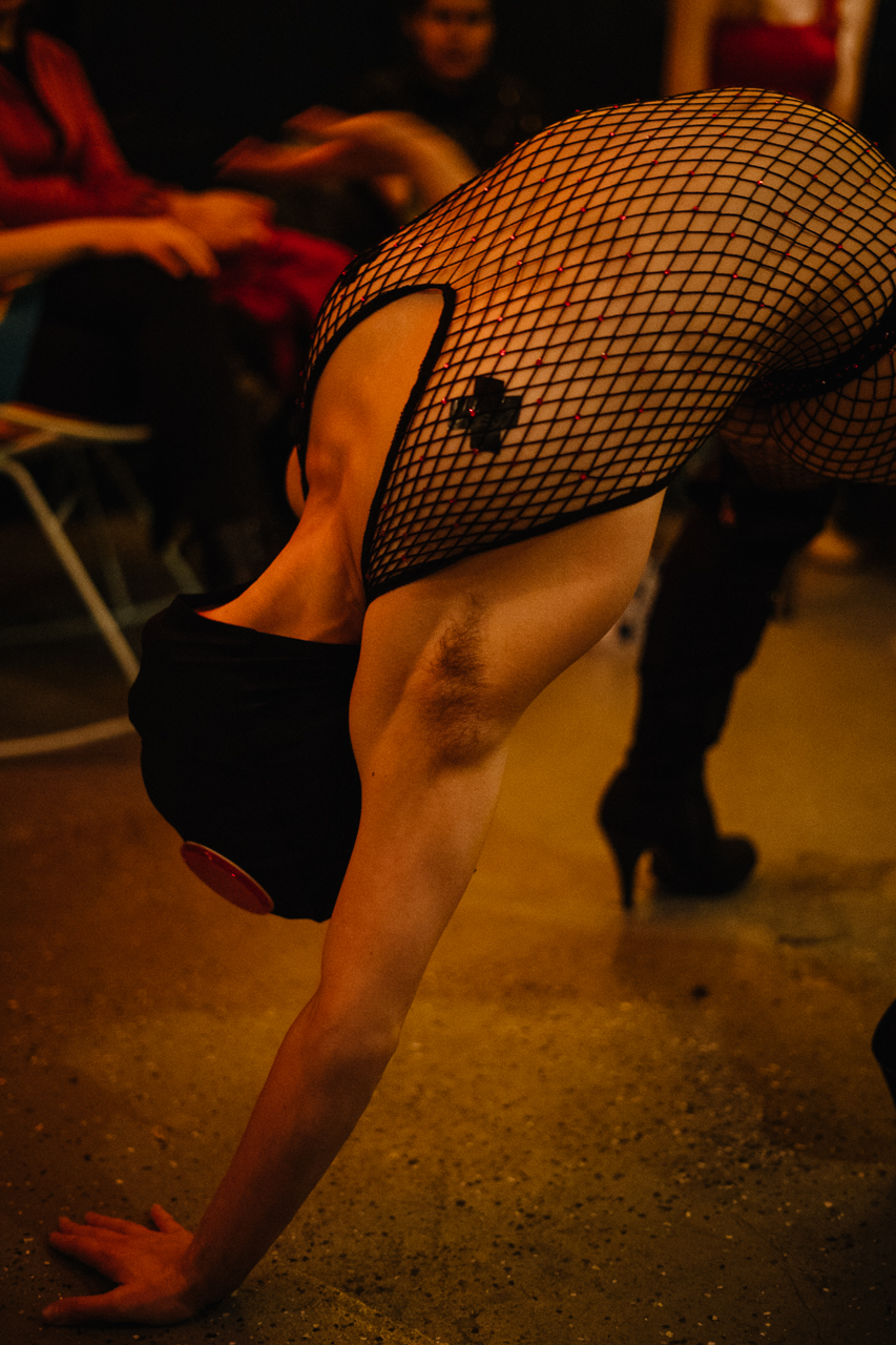 A burlesque dancer in a bridge pose