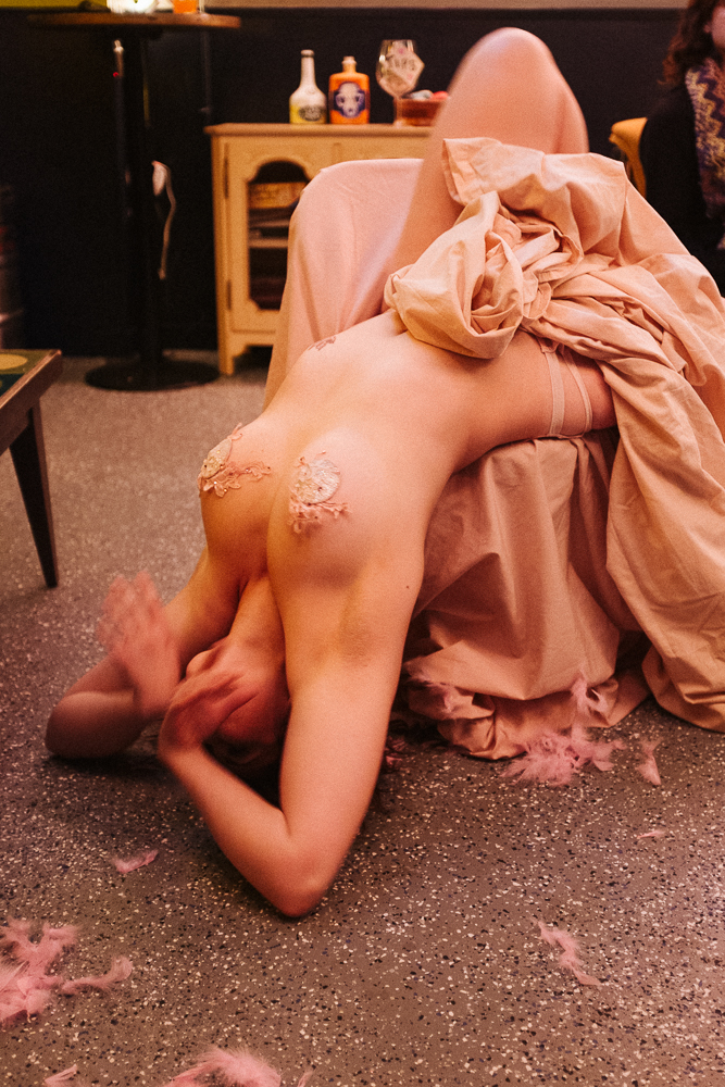A burlesque dancer performing using a chair
